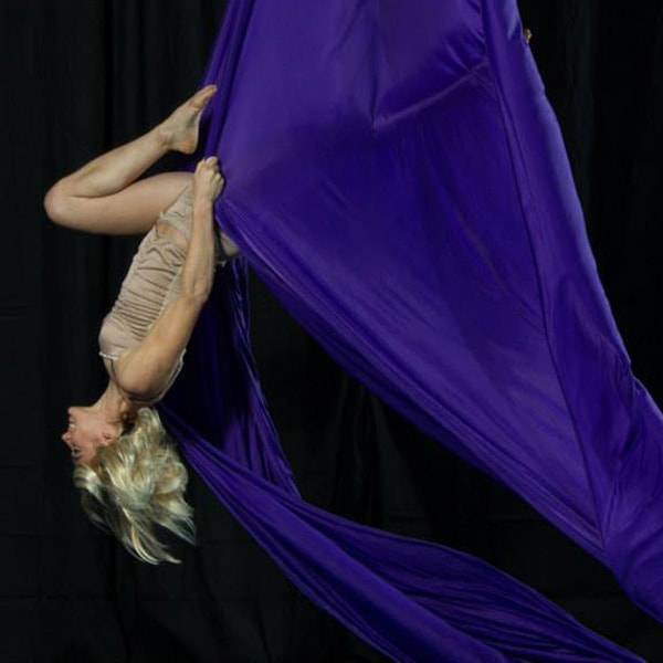 Mrs. Angel Griffin performing on aeriel silks