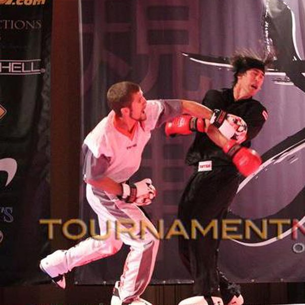Mr. Jack Felton landing a punch at Grand Champion match
